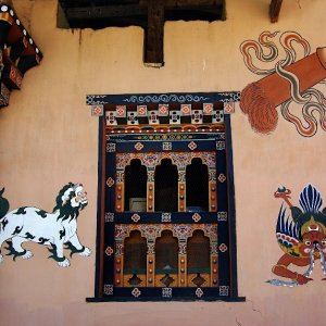 Painted decoration on a traditional house in Lobesa village near Chimi Lhakhang, Bhutan